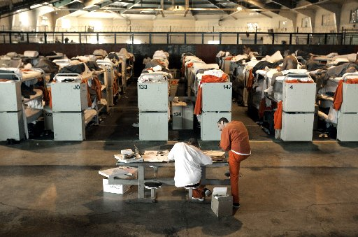 758614 bytes; 2000 x 1328; ORG XMIT: CARP102 ** ADVANCE FOR DEC. 1** FILE ** In this Aug. 3, 2006 file photo, inmates are seen