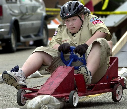 572918 bytes; 2000 x 1712; ORG XMIT: INELK105 Boy Scout Taylor Urednick holds on tight as he runs over a lane divider during th