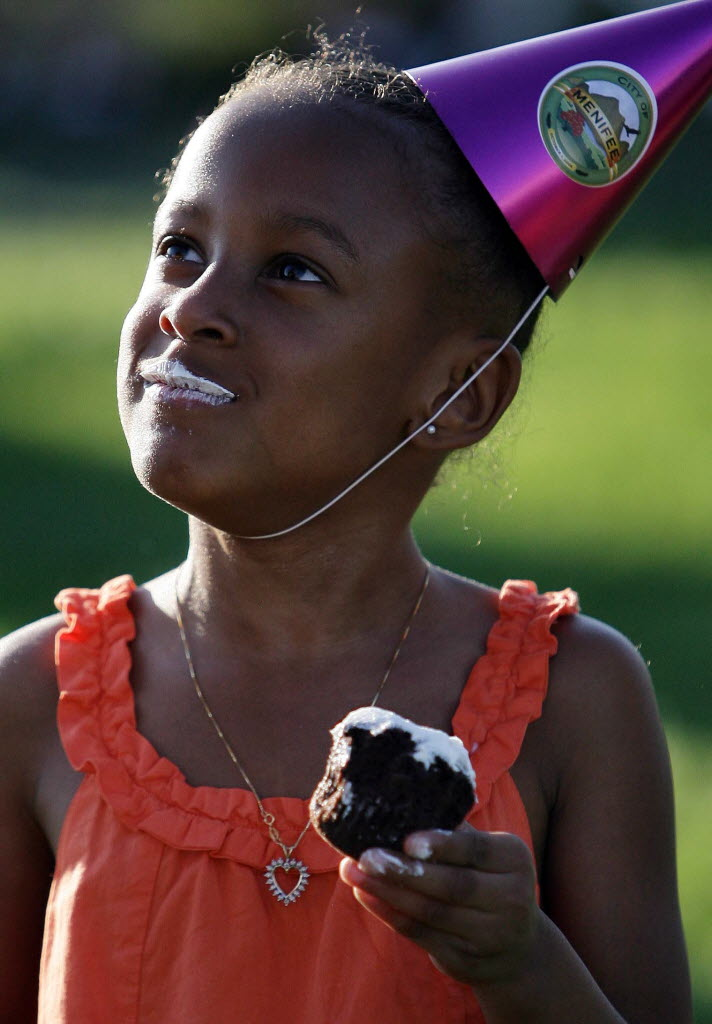 231775 bytes; 1519 x 2183; Ja-Nae McCoy, 4, enjoys a cup cake during the City of Menifee's third birthday party at Wheatfield P