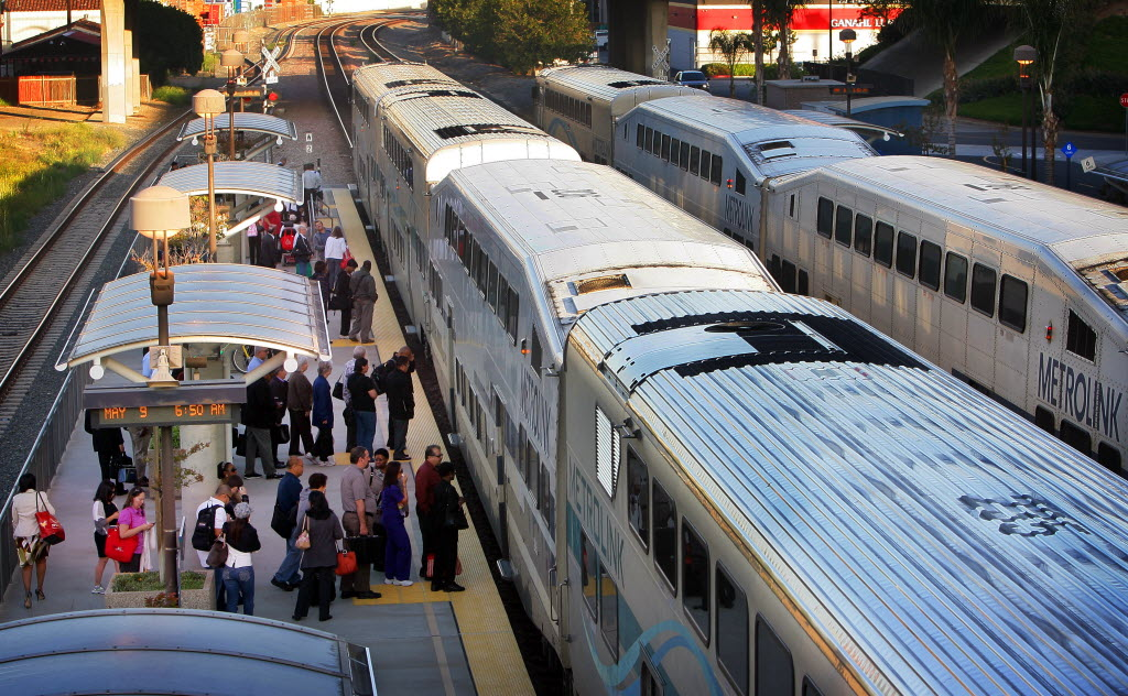 6745117 bytes; 3324 x 2052; Commuters board a Metrolink train at the Corona station on Wednesday, May 9, 2012.  Metrolink is fac