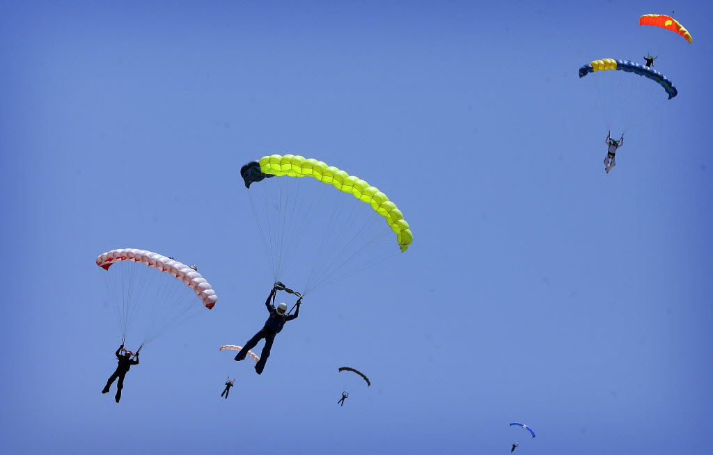 5139259 bytes; 3116 x 1992; Skydivers prepare for landing after a practice dive on Wednesday, May 16, 2012.  Skydive Perris is h