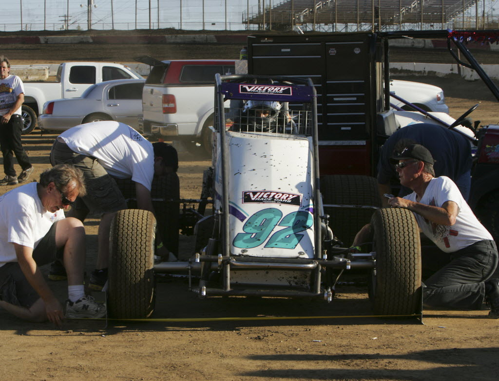 5643939 bytes; 2992 x 2284; Crew members measure the tires on David Cardey, of Riverside, new sprint car at the Perris Auto Spee