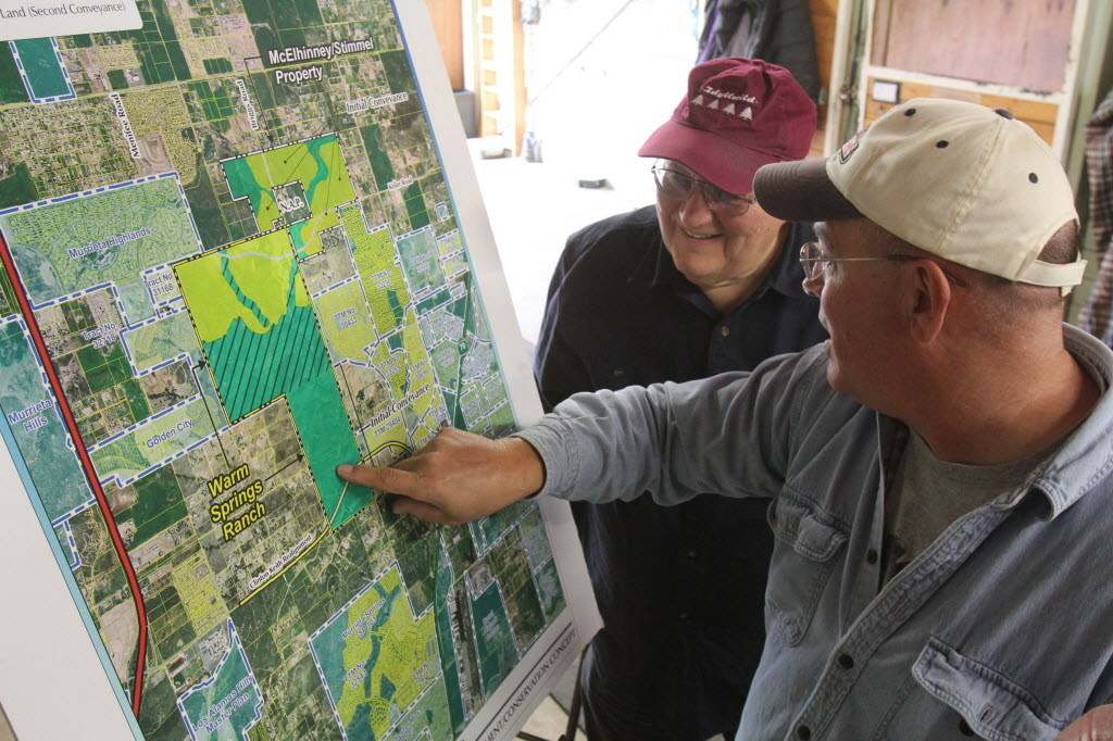 648467 bytes; 2592 x 1728; Marty Rosen (left) and Rick Croy look at a map showing the McElhinney/Stimmel Conservation Land east