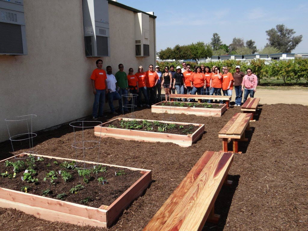 300247 bytes; 1280 x 960; Volunteers pose at Oak Grove at the Ranch in Perris after building elevated garden boxes.