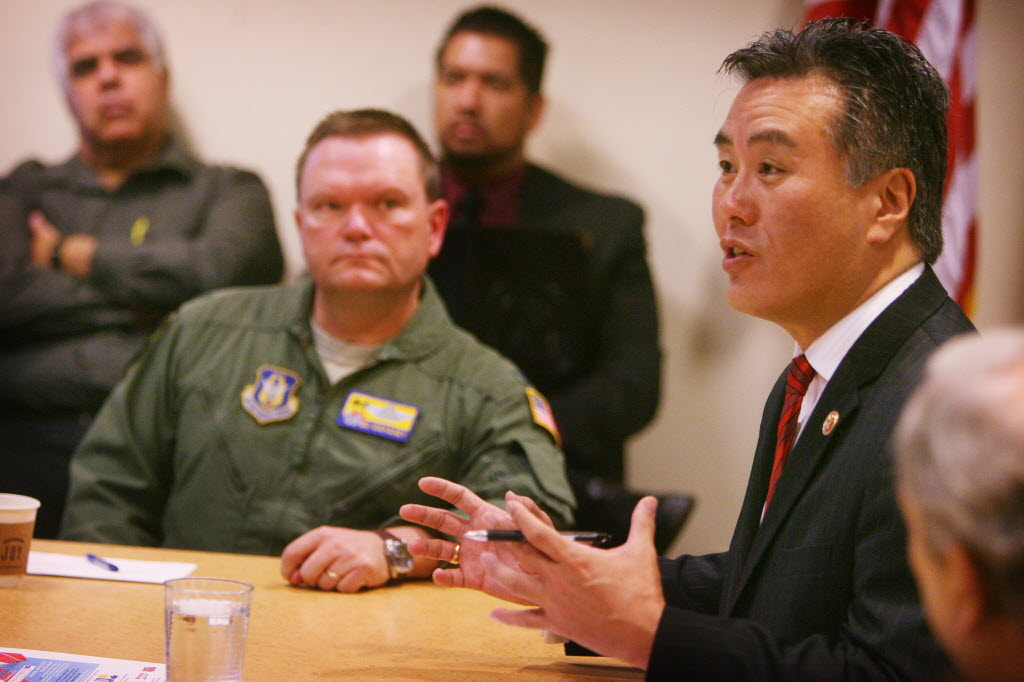 8247364 bytes; 3326 x 2217; Congressman Mark Takano makes a point, at right,  as Colonel Samuel Mahaney Commander, 452nd Air Mob