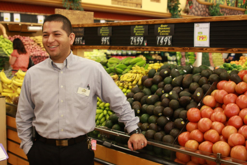 687152 bytes; 3888 x 2592; Juan Alvarado, manager of the Rio Rancho Market in Perris, is all smiles as he stands near a display