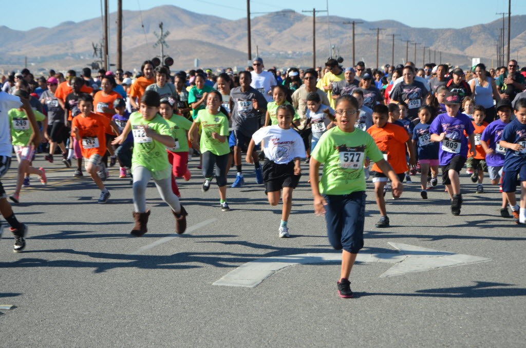 1346673 bytes; 4928 x 3264; Hundreds of runners take off May 11 from the starting line of the Fourth Annual Fun Run.