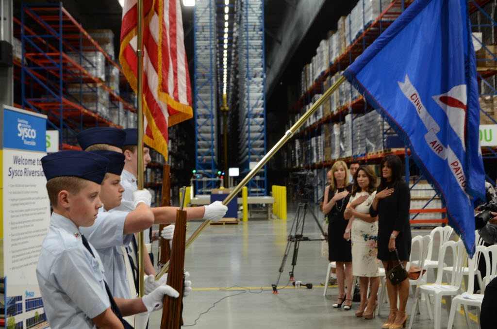1085078 bytes; 4928 x 3264; Members of a color guard take part in the opening ceremony of the Sysco Riverside warehouse on May 1