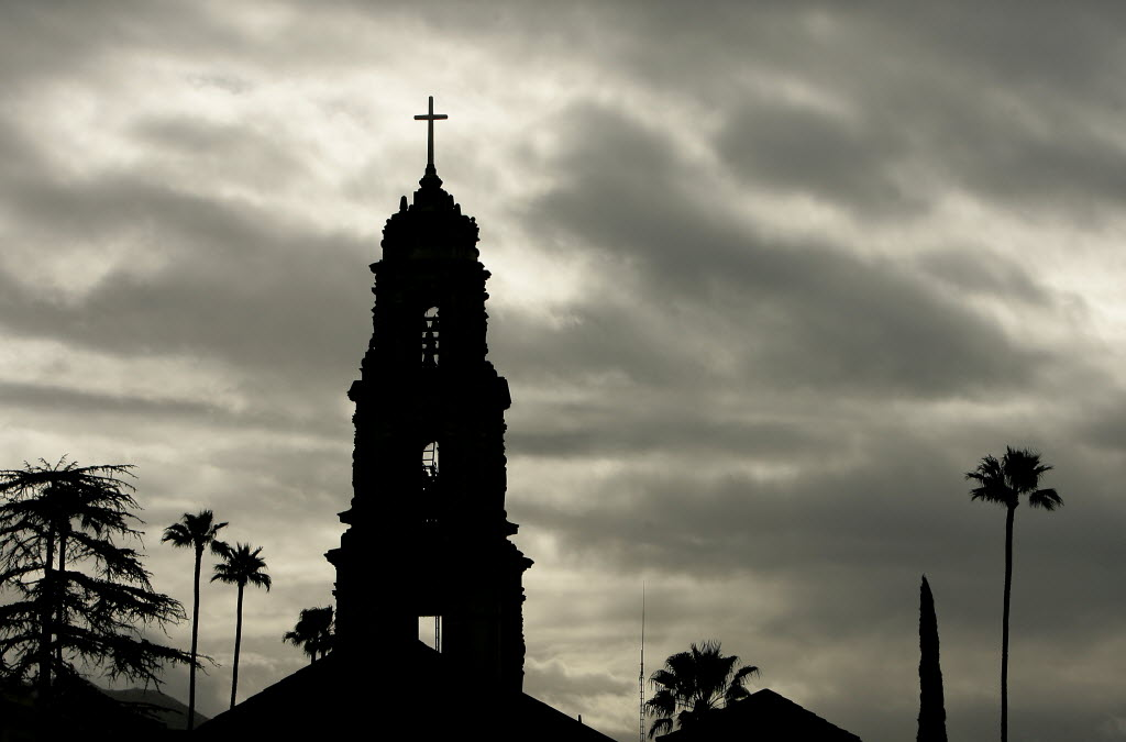 2947486 bytes; 3064 x 2020; The bell tower at First Congregational Church in Downtown Riverside sits silhouetted under the cloud